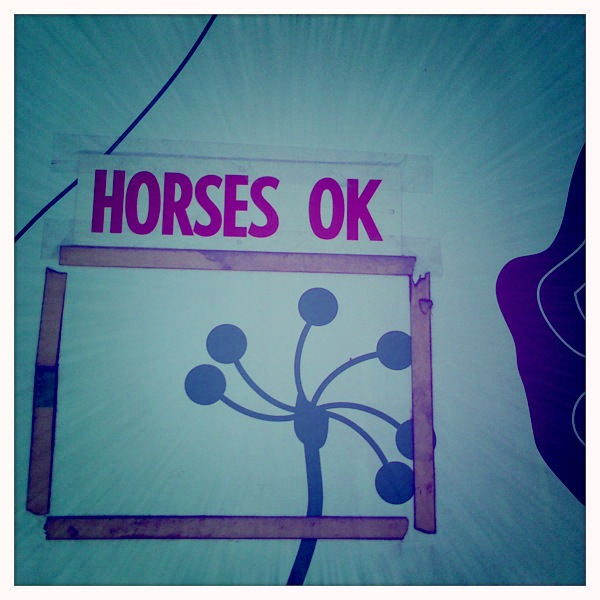 horses OK?? sign on abbot kinney garage